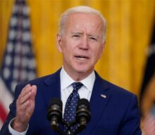 Biden calls for de-escalation with Russia following sanctions, proposes meeting with Putin